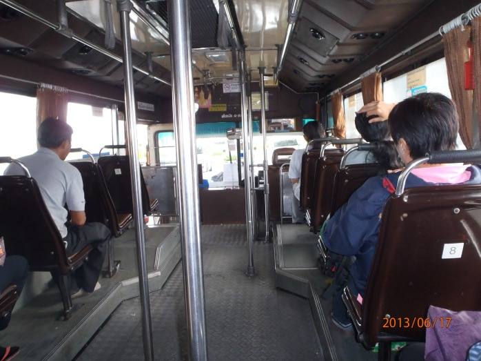 Bangkok city bus. Rush hour. Giant rolling suitcase. Not my best plan.